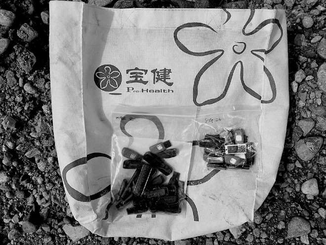 USB drives filled with foreign content and ready to be taken across the border in a plastic bag, lying on the bank of the Tumen River.